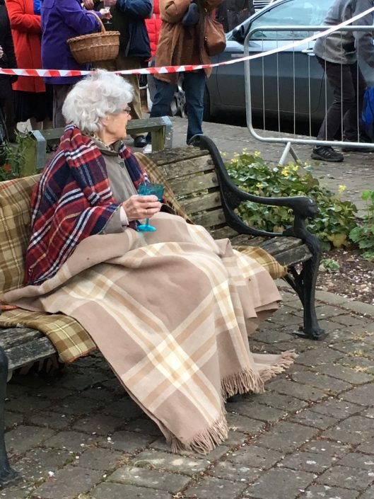 Elderly lady sitting on bench