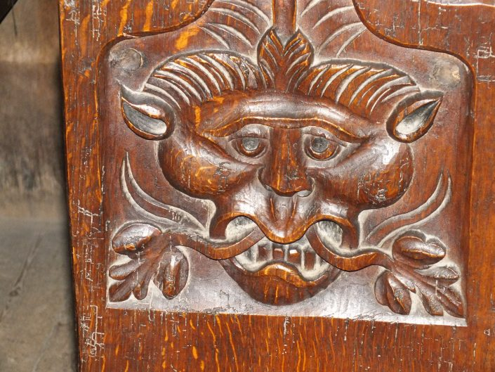 A wooden carving of a pagan creature