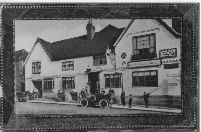 A historical photo of the Commercial Hotel with cars outside