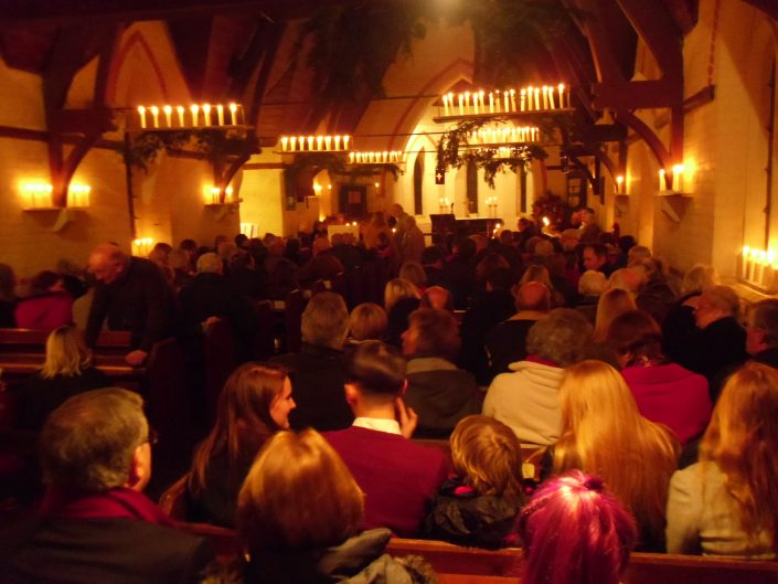 A candle lit evening in church Christmas Eve Service